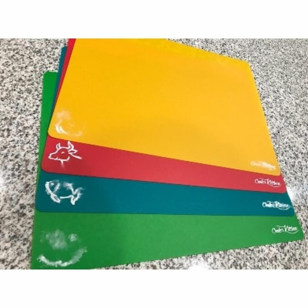 Extra Thick Flexible Plastic Cutting Board Mats with food icons partly erased