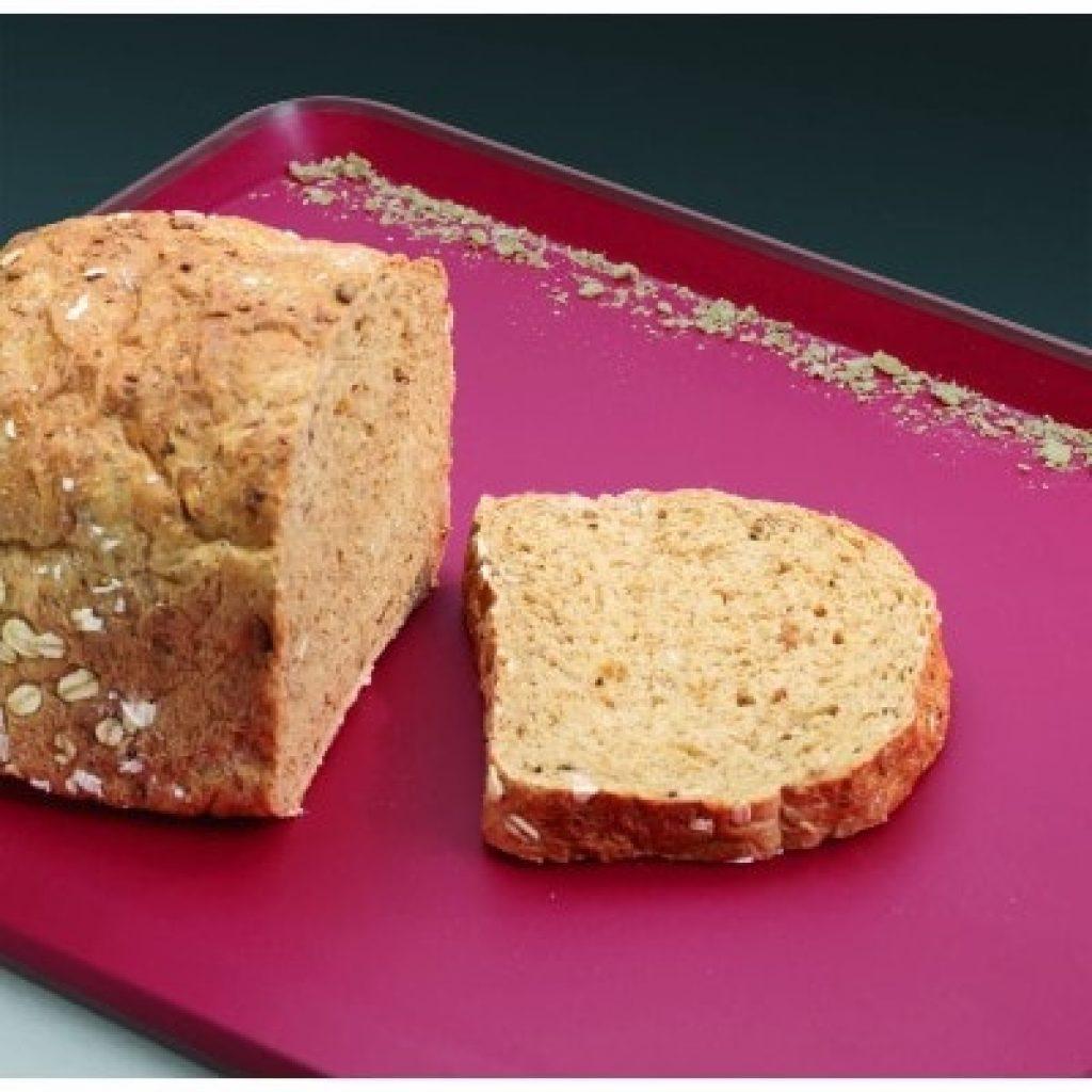 Joseph Joseph 60002 Cut & Carve Multi-Function Cutting Board with bread on it