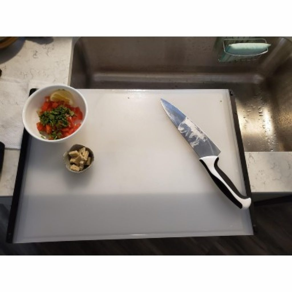 OXO Good Grips Carving and Cutting Board with vegetables